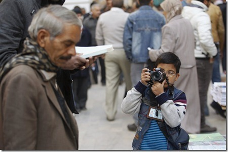 اصغر مصور فوتوغرافي عراقي عمره 8 سنين