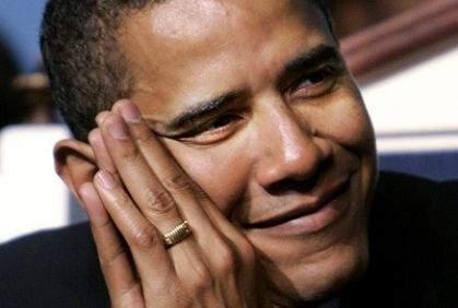 لن تصدق : الكلمه المنقوشه علي خاتم اوباما هي لا اله الا الله