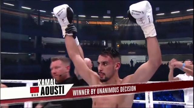 شاهد بالصور:الملاكم الريفي بن أزغنغان كمال أوسطي يحرز لقب العالم بأروبا ببطولة Glory
